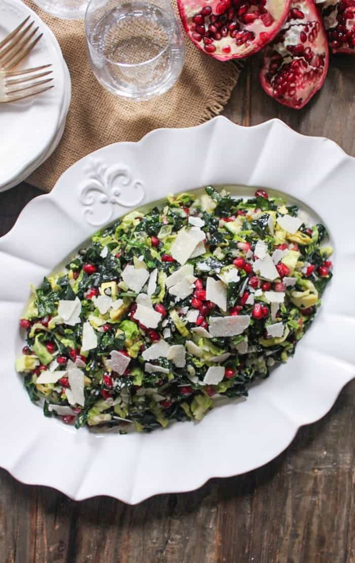 Kale and Brussels Sprout Salad with Pomegranate and Avocado - what to bring to friendsgiving or thanksgiving