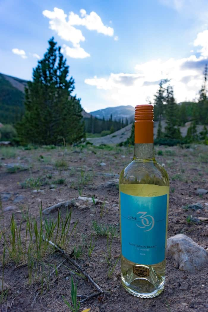 Four tips for car camping in comfort – Campsite with a view, Air mattress for a good night sleep, Line 39 wine and cheese for happy hour and a Weber® Grill for cooking dinner AD Msg 4 21+