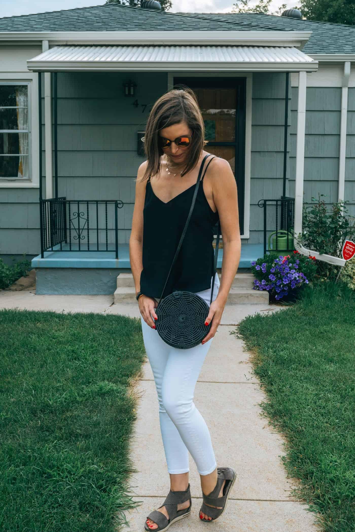Amerii Rattan Black Bag, white jeans black tank top | Blue Mountain Belle