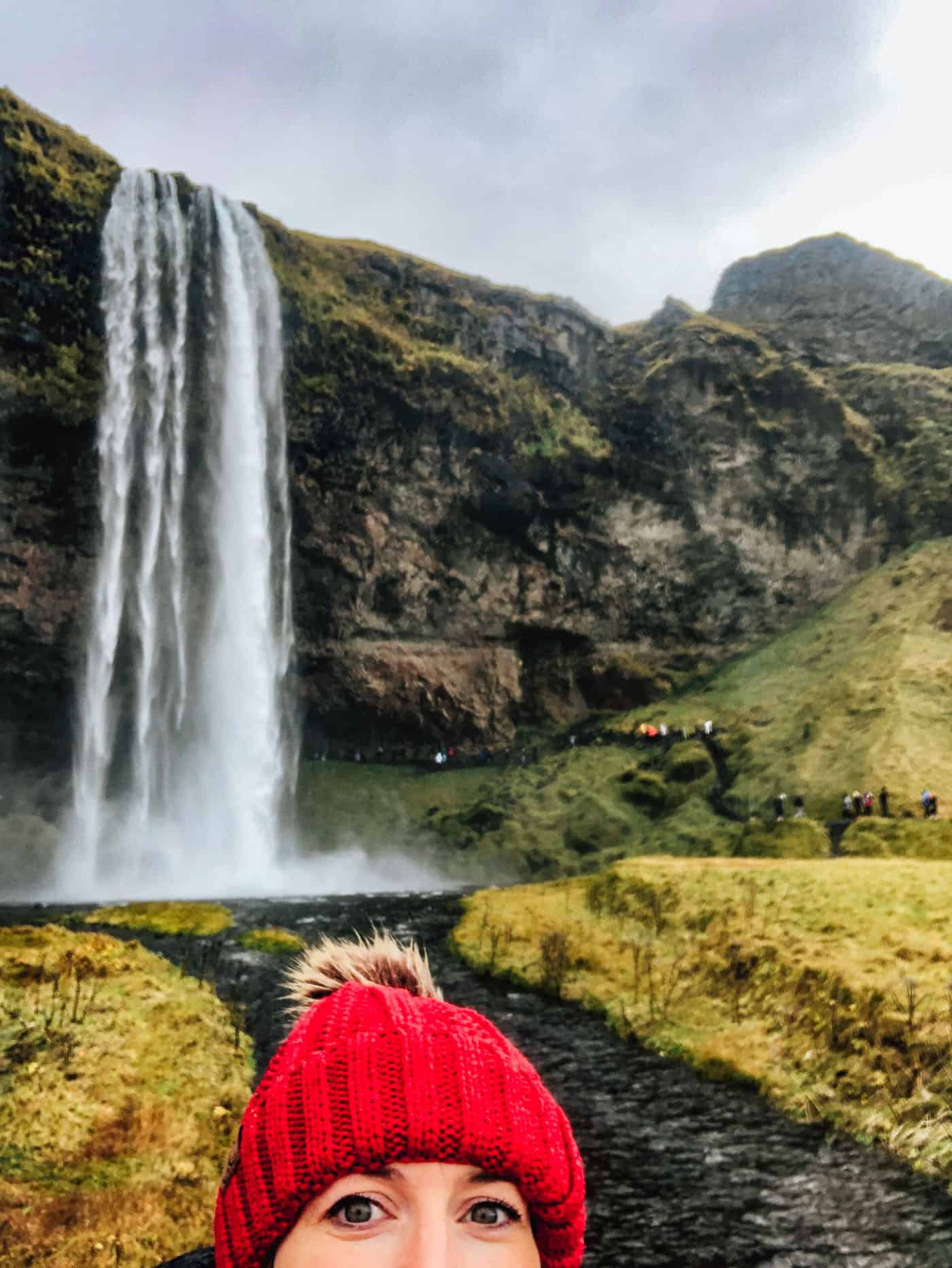 Channing at Seljalandsfoss waterfall in Iceland